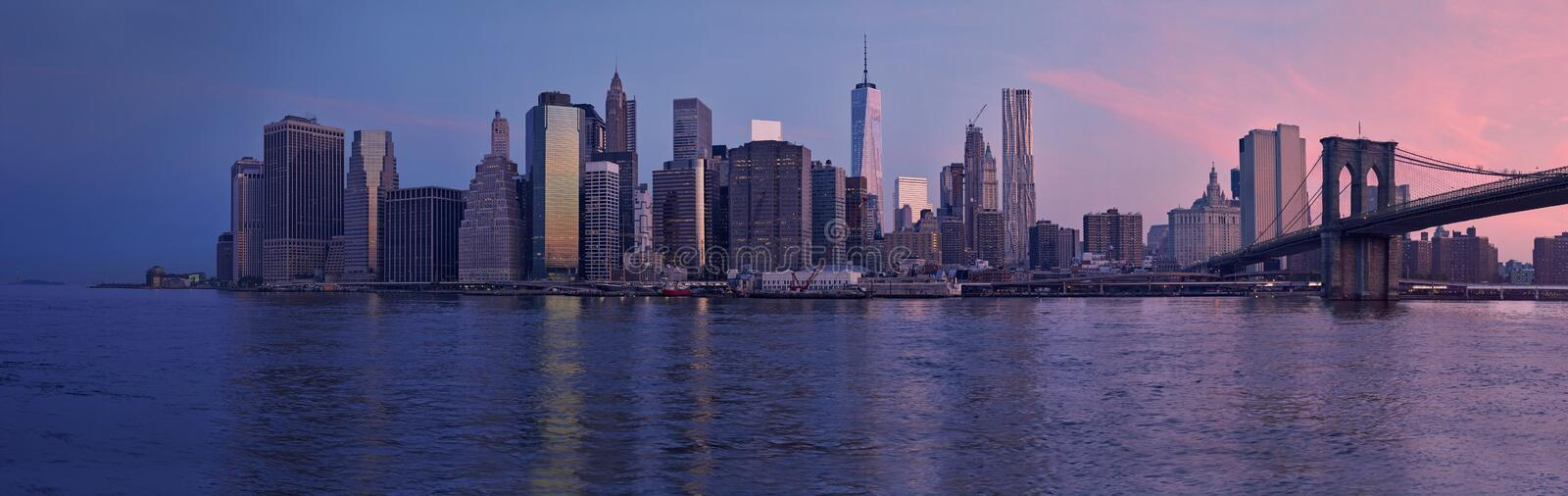 NYC Manhattan financial district at the morning. With skyscrapers over East River royalty free stock image