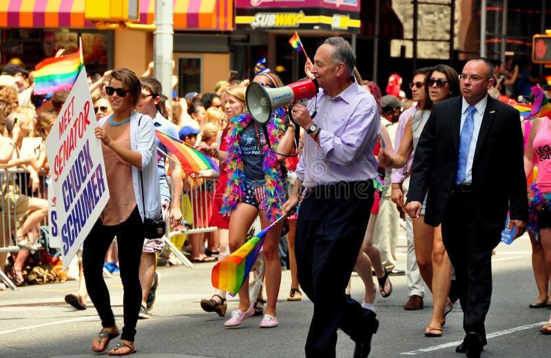 NYC: Senator Chuck Schumer at Gay Pride Parade. United States Senator Chuck Schumer (center, with bullhorn) marching in the 2013 Gay Pride Parade on NYCs Fifth royalty free stock photo