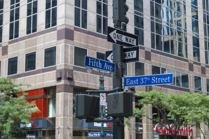 NYC signpost in Midtown Manhattan at landmark streets 5th Ave and 37th St, New York City. USA royalty free stock photos