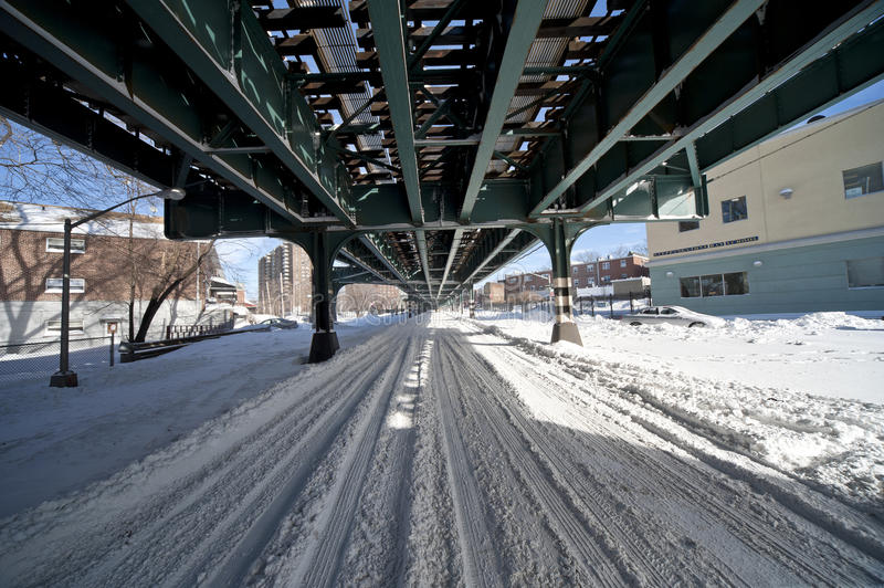 NYC Snow. Underneath Elevated Train Tracks in the Bronx royalty free stock image