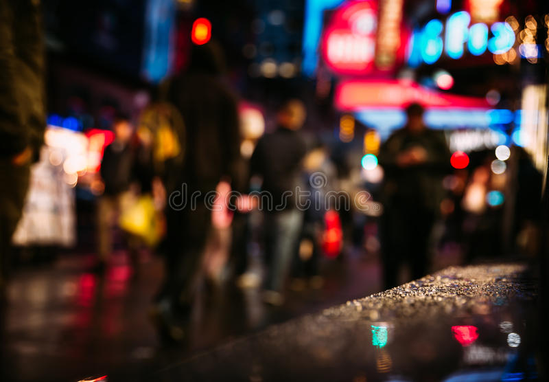 NYC streets after rain with reflections on wet asphalt. Lights and shadows of New York City. NYC streets after rain with reflections on wet asphalt. Blurred stock photo