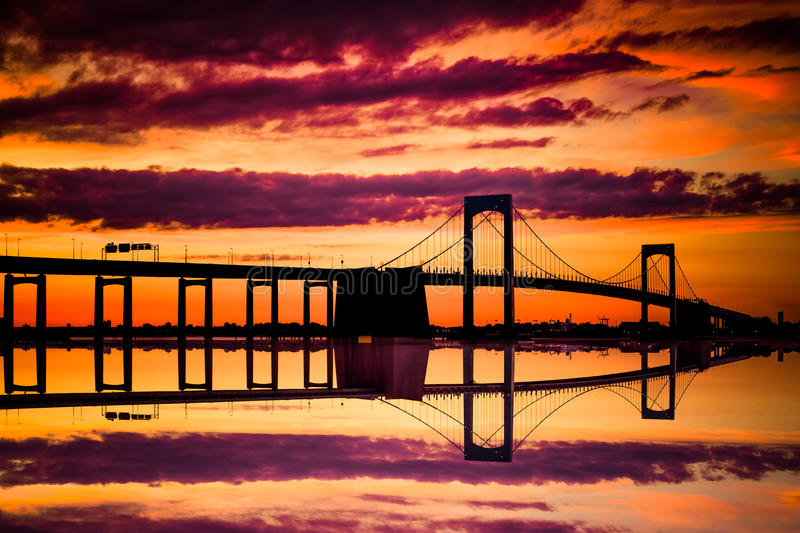 NYC Throgs Neck Bridge Sunset. New York City Throgs Neck Bridge from Queens NYC to the Bronx with colorful sunset sky stock image
