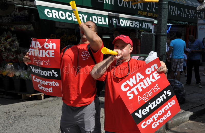 NYC: Trabajadores de pulso del teléfono de Verizon fotografía de archivo libre de regalías