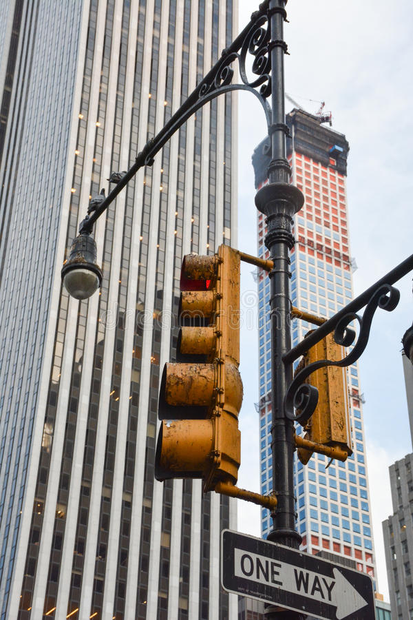 NYC Traffic light. A populated city has polluted objects. A traffic signal located on 5th Ave, NYC royalty free stock image