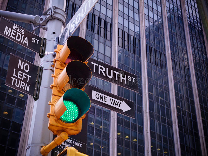 NYC Wall street yellow traffic green light black pointer guide O. Ne way to truth. No way, no turn to Mass media fake news. Right Choice is truth. Mass media stock images