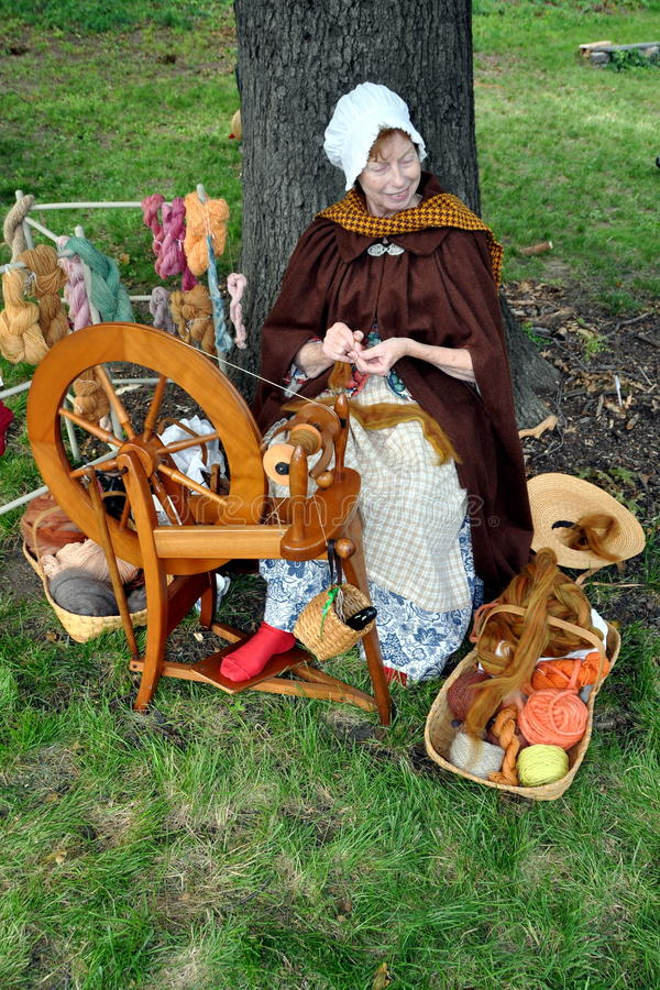 NYC: Woman Using Spinning Wheel stock images