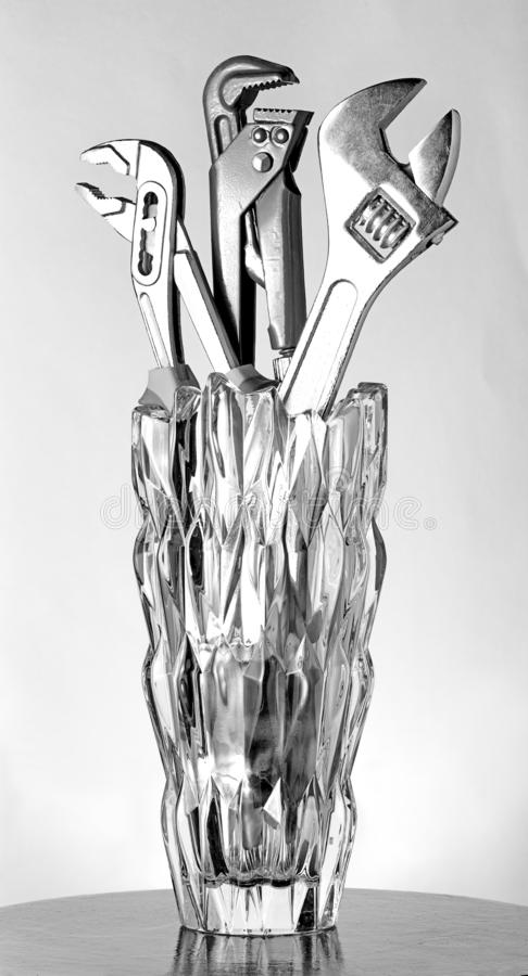 Nyckel- rörmokeriexponeringsglasvas royaltyfri bild