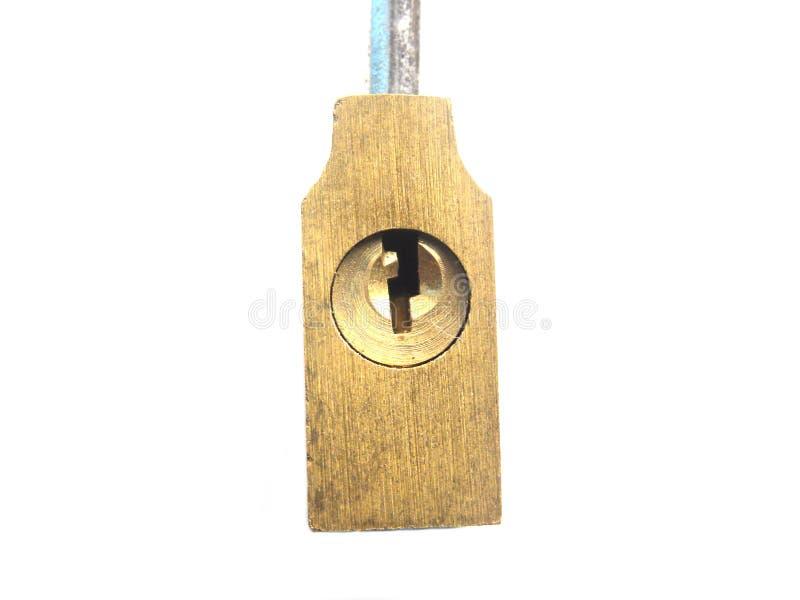 Nyckelhål av det lilla mässingsmetalllåset arkivbilder
