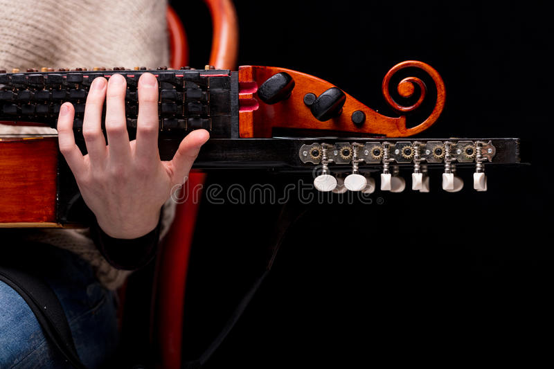 Nyckelharpa`s scroll, headstock and pegbox details stock photo