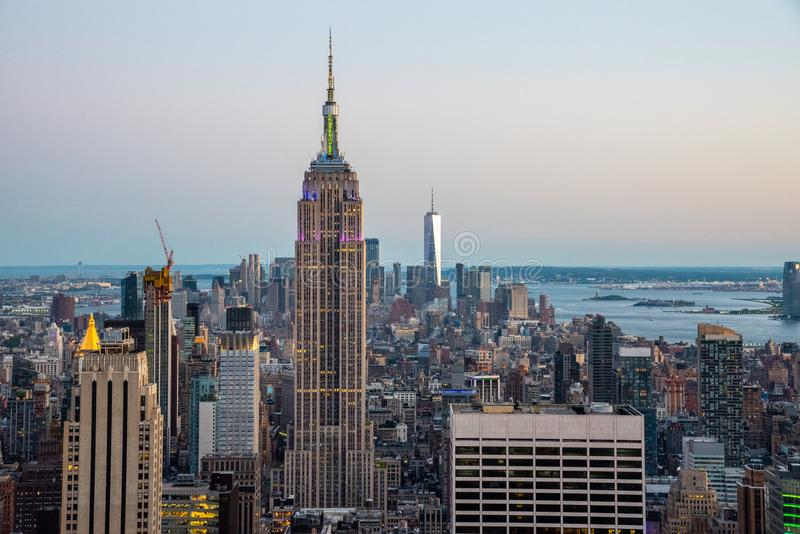 Looking South from the top of Manhattans midtown during 2019 gay pride (NYC, USA. NYCs lower Manhattan with the Empire State Building from a high up point in royalty free stock images