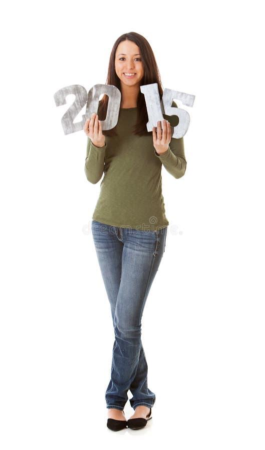 NYE: Uśmiechnięta kobieta Trzyma Up obraz stock