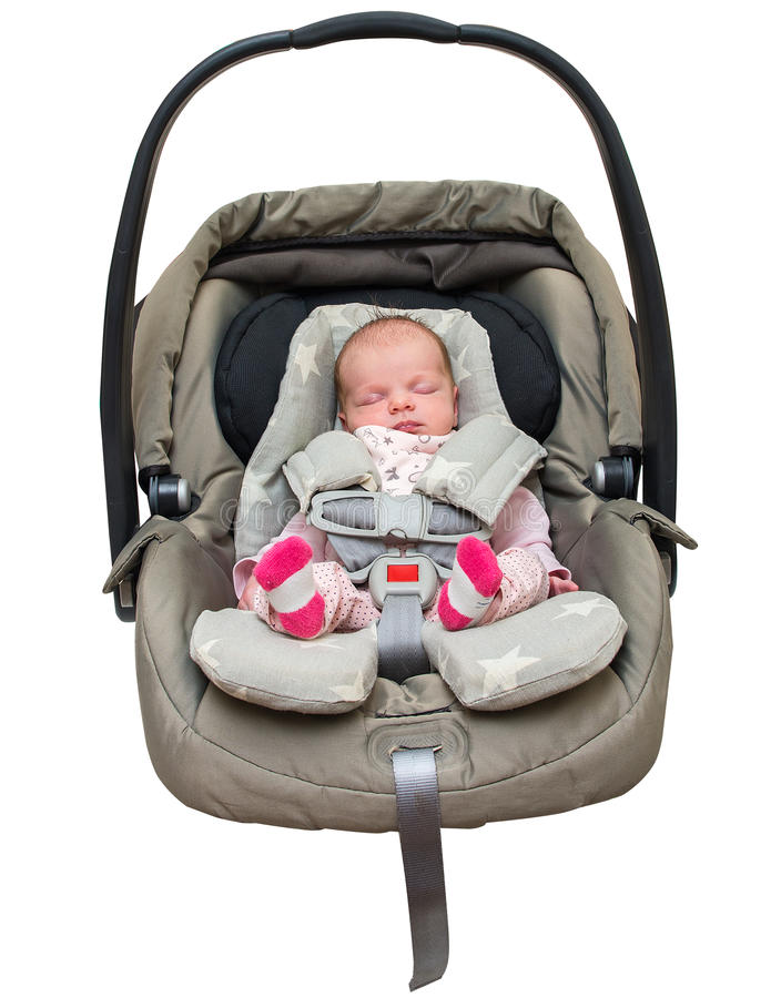 Nyfött behandla som ett barn flickan i ett bilsäte royaltyfri fotografi