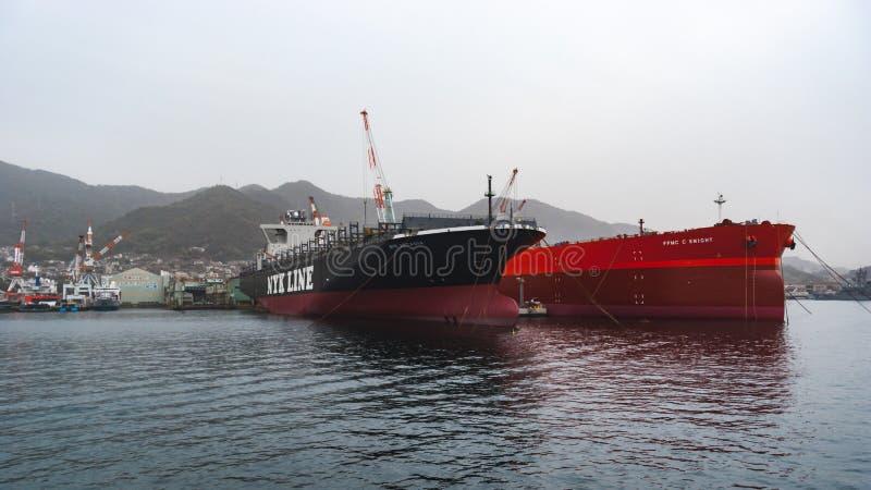 NYK Arcadia (container ship) and FPMC C Knight (crude oil tanker. Kure, Japan - November 13, 2010: NYK Arcadia (container ship) and FPMC C Knight (crude oil stock image