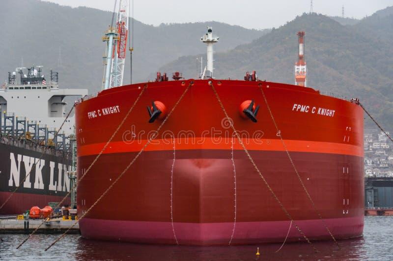 NYK Arcadia (container ship) and FPMC C Knight (crude oil tanker. Kure, Japan - November 13, 2010: NYK Arcadia (container ship) and FPMC C Knight (crude oil royalty free stock photos