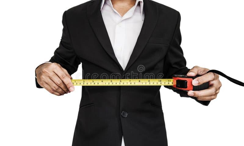 Nylon die de metingsband van de zakenmanholding, op witte achtergrond wordt geïsoleerd royalty-vrije stock fotografie