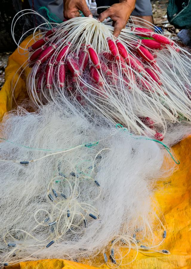 Nylon fishing net with float line attached to small plastic floats. Fishermans Nylon fishing net with float line attached to small plastic floats royalty free stock image