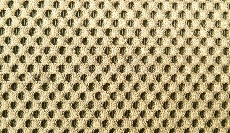 Nylon. Golden nylon pattern close up royalty free stock images