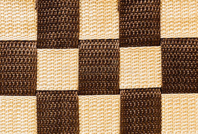 Nylon texture. Brown and yellow textured surface of nylon strings royalty free stock photos