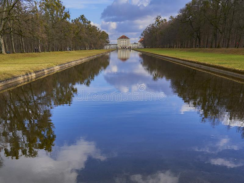 Nymphenburg castle, Munich, Germany, view along the canal royalty free stock image