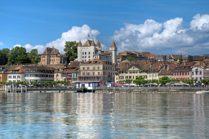 Nyon, Switzerland. Waterfront of Nyon on the shore of Lake Geneva (Lake Leman), Switzerland with its while castle overlooking. HDR image royalty free stock image