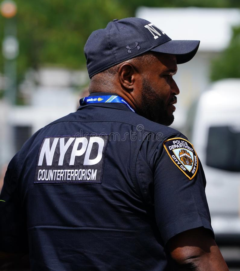 NYPD counter terrorism police officer provides security at National Tennis Center during 2018 US Open in New York. NEW YORK - SEPTEMBER 1, 2018: NYPD counter stock photo