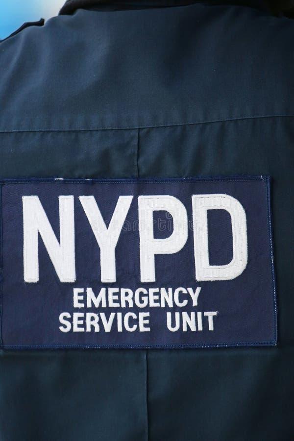 NYPD-de ambtenaar die van de hulpdiensteenheid veiligheid verstrekken op Nationaal Tenniscentrum tijdens US Open 2014 stock foto's