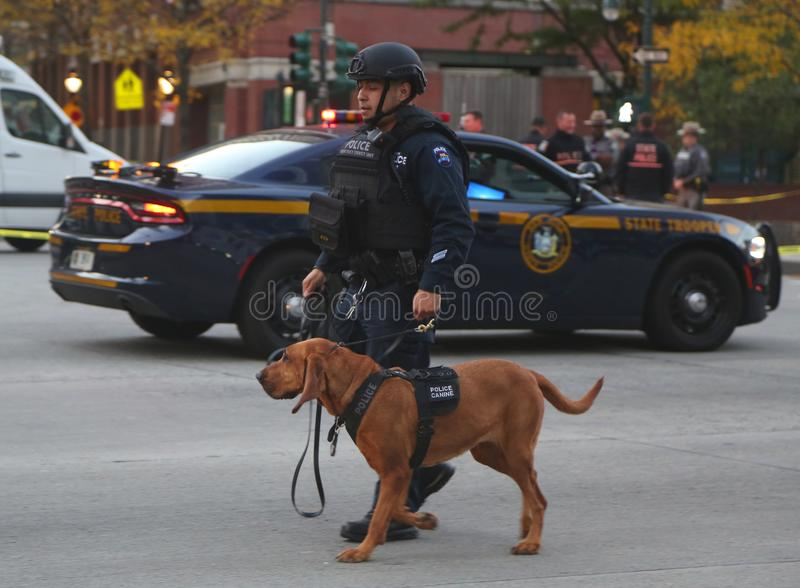 NYPD emergency service unit police officer with K-9 dog at the crime scene near a terror attack site in lower Manhattan. NEW YORK - OCTOBER 31, 2017: NYPD stock photos