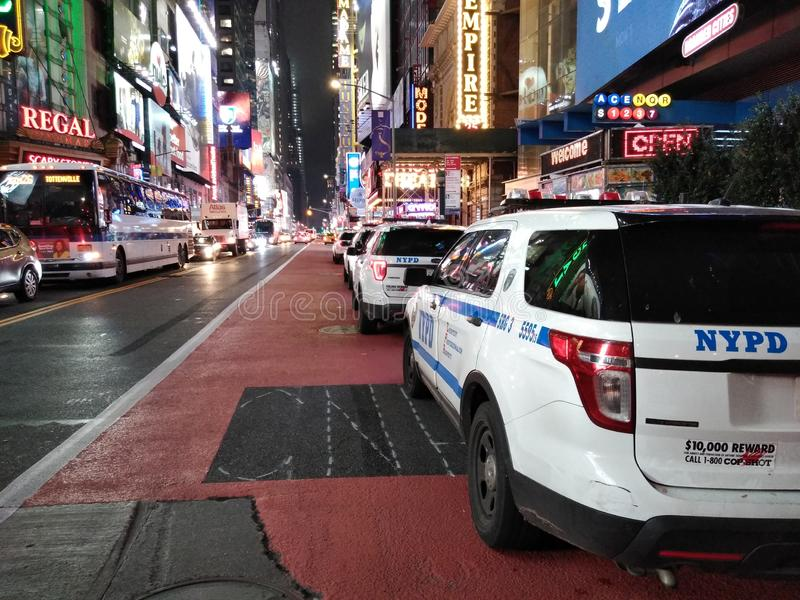 NYPD Vehicles Parked On 42nd Street, Times Square, NYC, NY, USA. Nighttime traffic on 42nd Street, near the corner of 8th Avenue, near Times Square. Police cars royalty free stock images