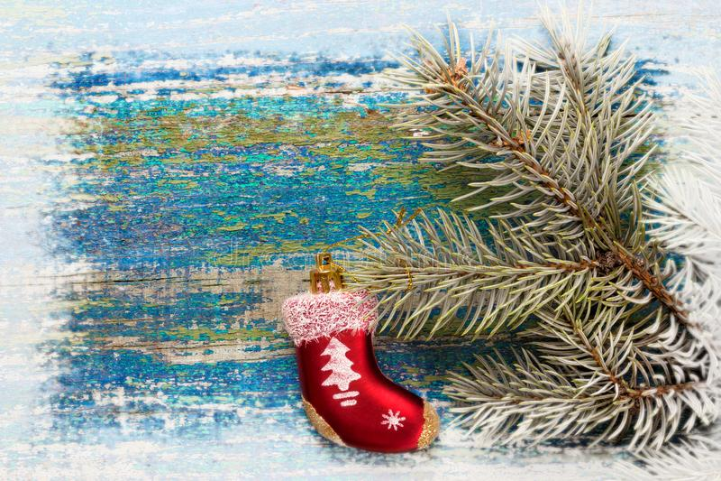 nytt år för bakgrundsjul Röd leksaksocka Santa Claus på woode arkivbilder