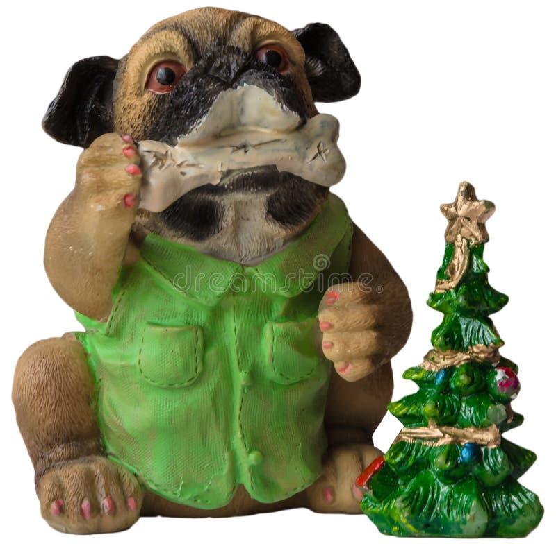 nytt år för kortjul Kopp med granträd, godisrottingar och röd klocka och kakor i formen av en hund På ljus backg för snö royaltyfria foton