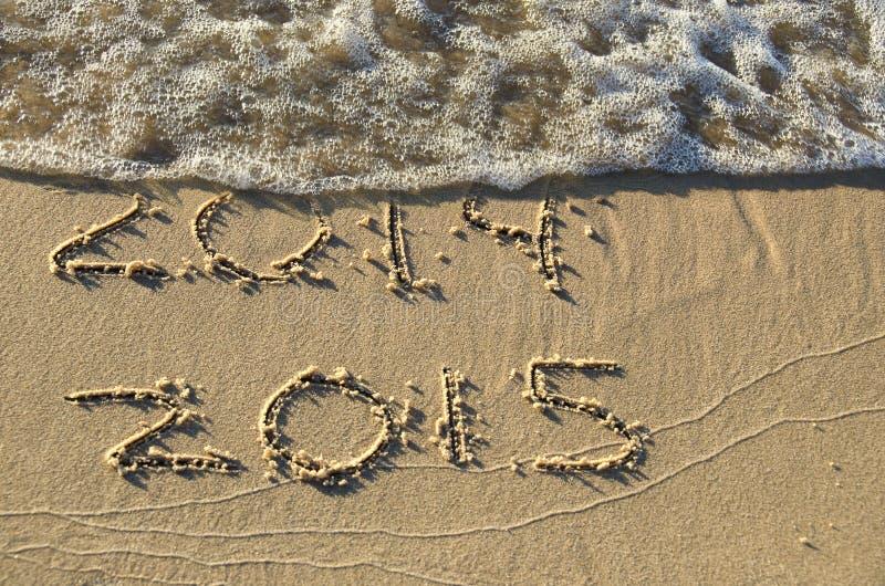 Nytt år 2015 på stranden royaltyfria foton