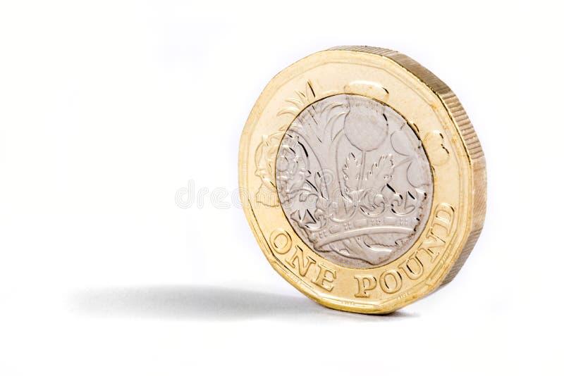 Nytt ett pundmynt royaltyfria bilder