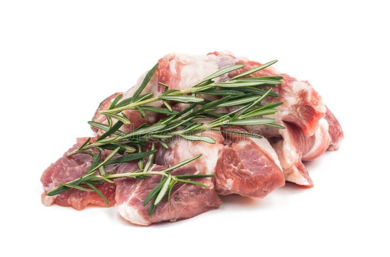 Nytt rått kött med rosmarin royaltyfri foto
