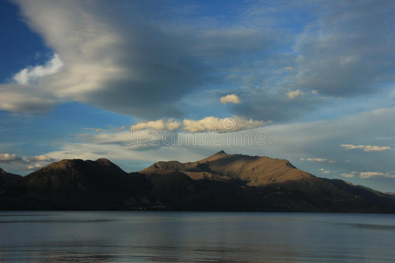 NZ, South Island, Queenstown, mountain and lake view royalty free stock images