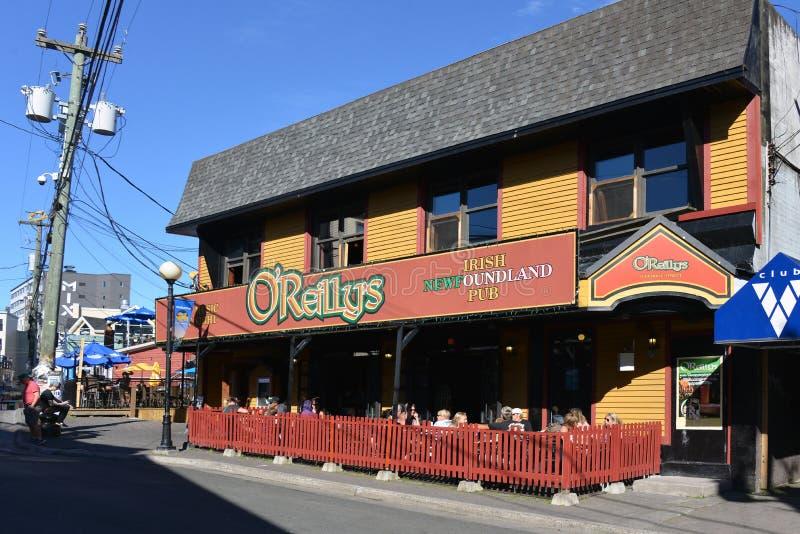 O'Reilly's pub on George Street in St. John's Newfoundland. St. John`s, NL, Canada - August 11, 2018: The popular Irish Newfoundland Pub O` stock images