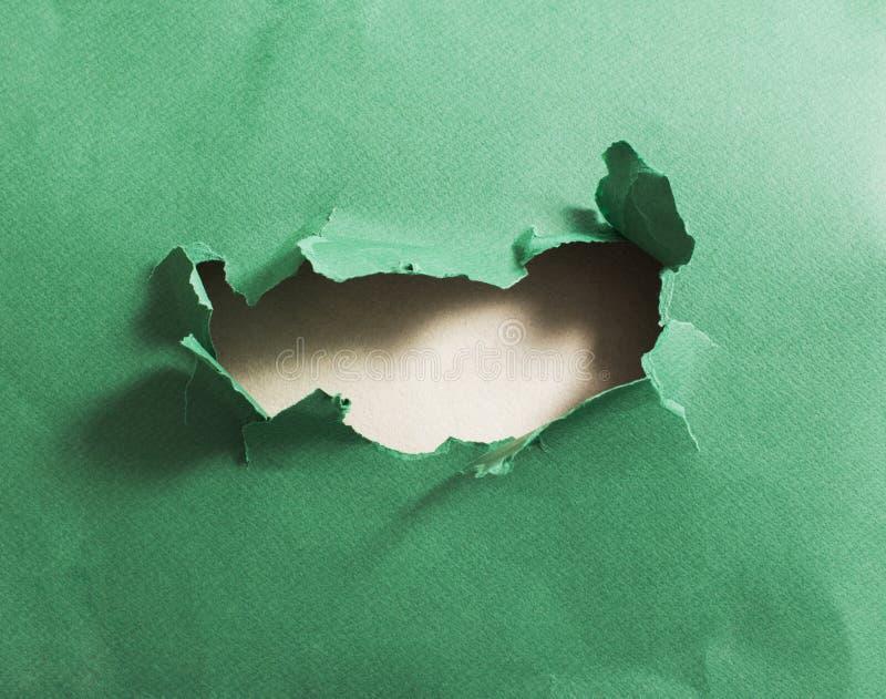 Отверстие в зеленой книге, абстрактной предпосылке стоковые изображения