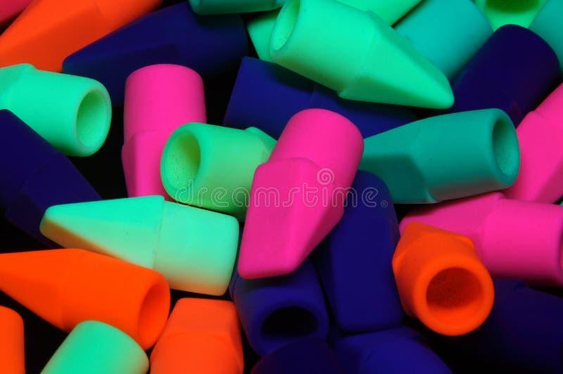 Ołówkowe gumki pod czerni światłem zdjęcie royalty free