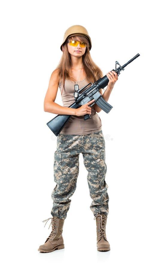 Żołnierz młoda piękna dziewczyna ubierał w kamuflażu z pistoletem fotografia royalty free