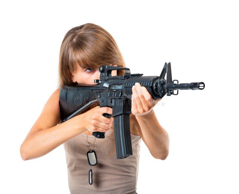 Żołnierz młoda piękna dziewczyna z pistoletem w jego ręce na bielu obrazy stock