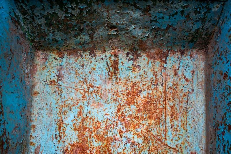 Ośniedziała błękitna i czerwień wyginająca się tekstura fotografia stock