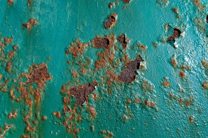 Ośniedziała cyraneczki powierzchnia z farby płatkowaniem, fotografia royalty free