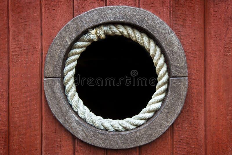 Ośniedziały Drewniany Porthole zdjęcia stock