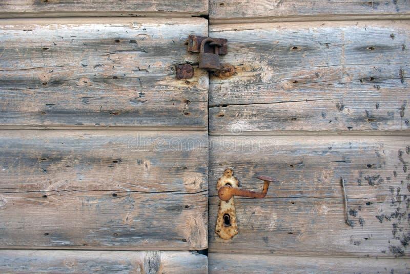 Ośniedziały kędziorek na starym drewnianym doorsc obraz stock