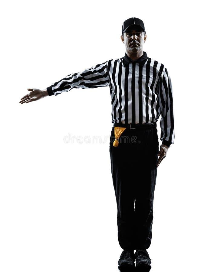 O árbitro do futebol americano gesticula a silhueta imagens de stock