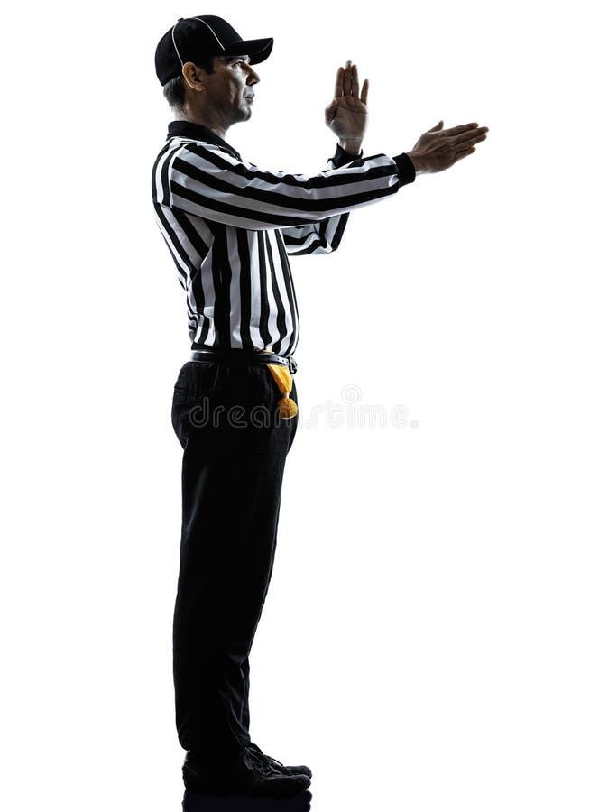 O árbitro do futebol americano gesticula a silhueta imagens de stock royalty free