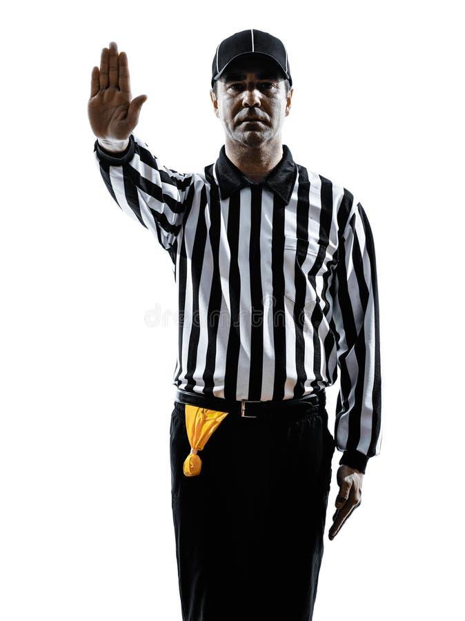 O árbitro do futebol americano gesticula a silhueta imagem de stock