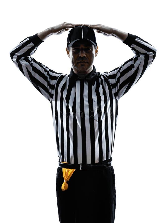 O árbitro do futebol americano gesticula a silhueta fotografia de stock