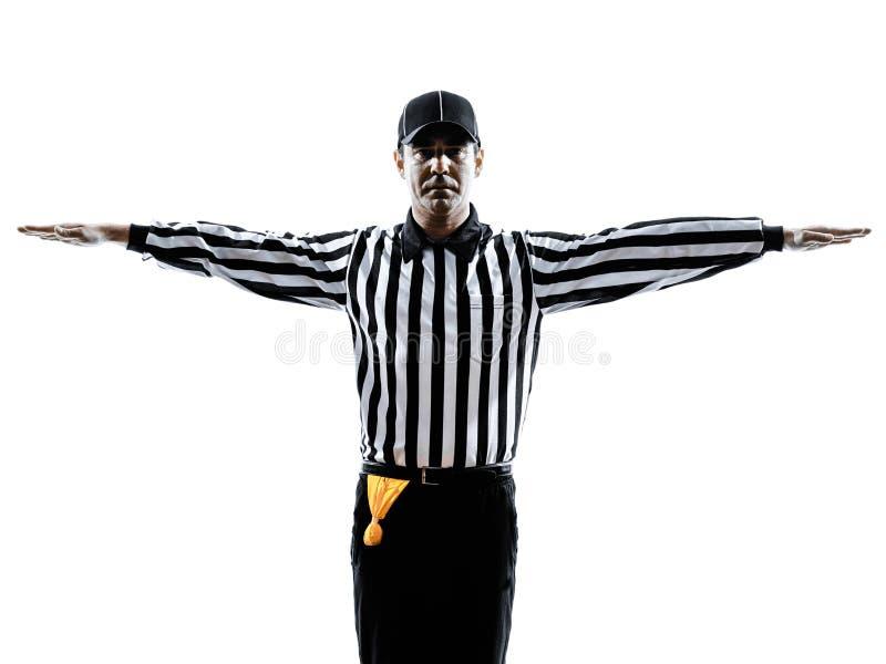 O árbitro do futebol americano gesticula a silhueta fotos de stock
