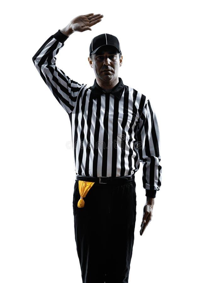 O árbitro do futebol americano gesticula a silhueta foto de stock