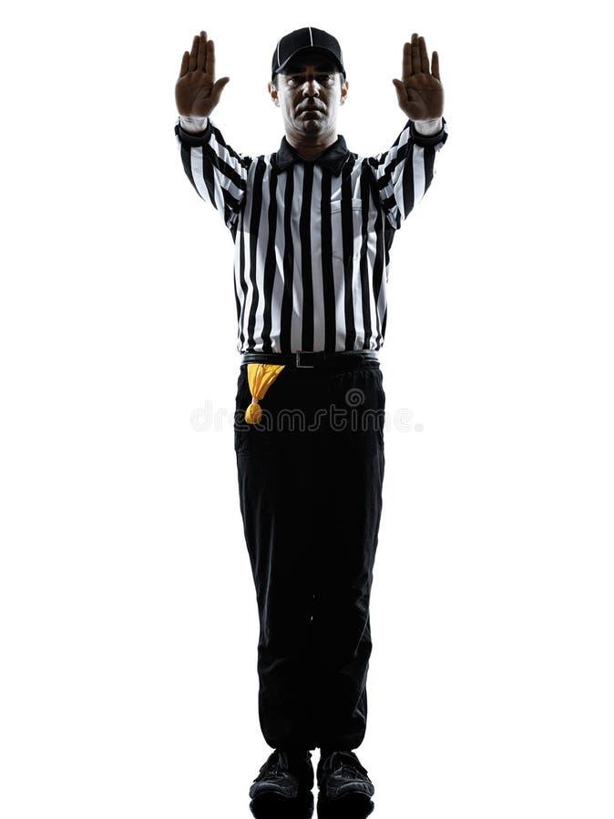 O árbitro do futebol americano gesticula a silhueta fotografia de stock royalty free